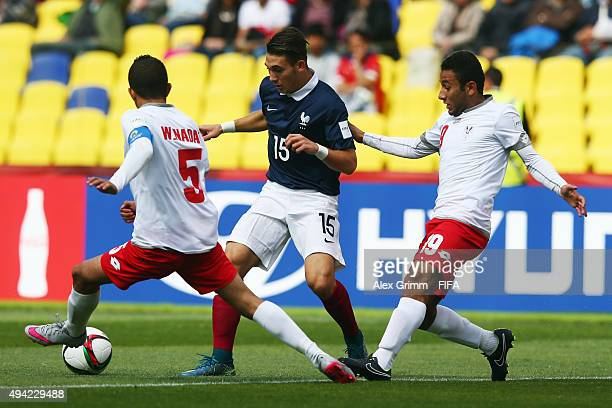 Maxime Pelican of France is challenged by Wasim Alnadaf and Ahmad Alkhassi of Syria during the FIFA U17 World Cup Chile 2015 Group F match between...