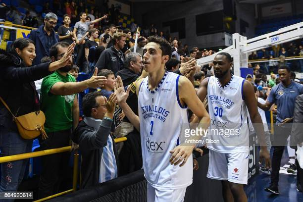 Maxime Roos and Florent Pietrus shakes hands with fans during the Pro A match between Levallois Metropolitans and Boulazac at Salle Marcel Cerdan on...
