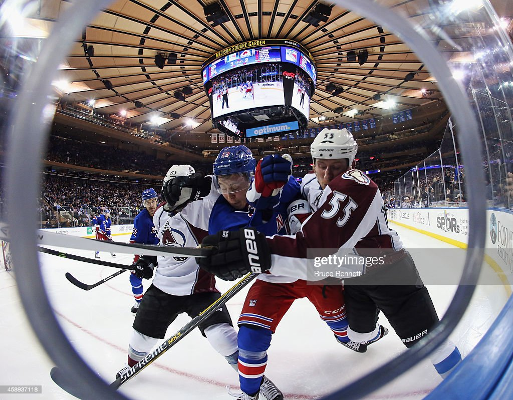 Maxime Talbot and Cody McLeod of the Colorado Avalanche combine to hit Jesper Fast of the New York Rangers at Madison Square Garden on November 13...