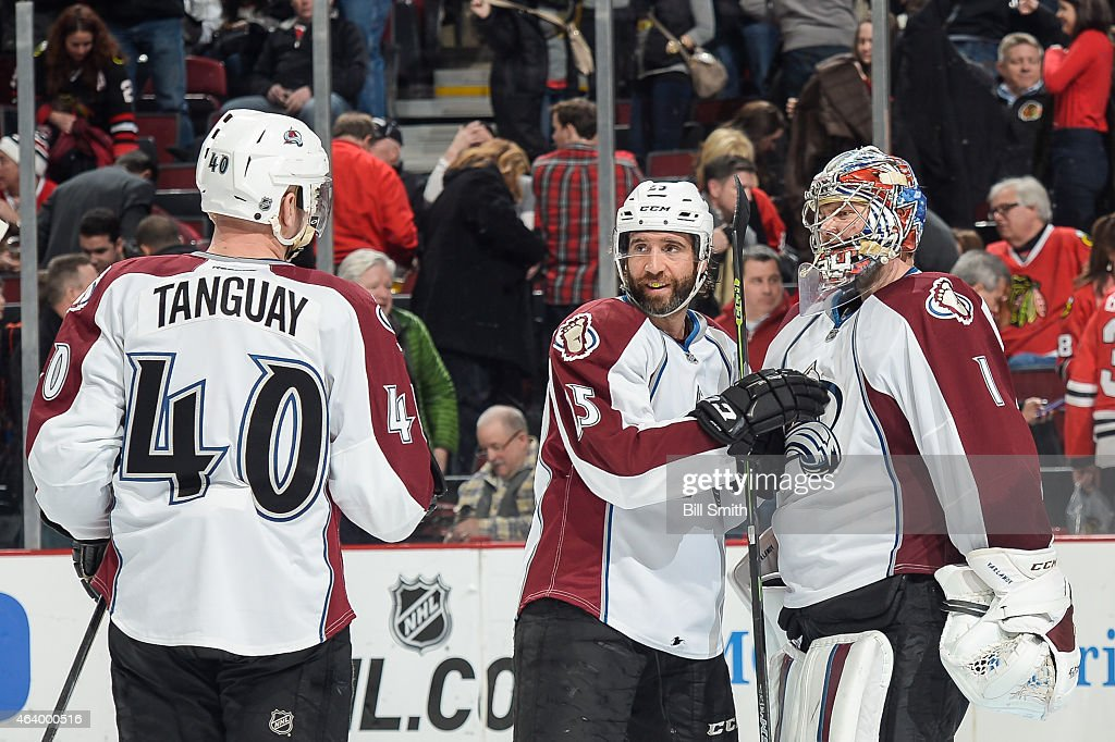 Maxime Talbot #25 and goalie Semyon Varlamov #1 of the Colorado Avalanche celebrate after defeating the Chicago Blackhawks 4-1 during the NHL game at the United Center on February 20, 2015 in Chicago, Illinois.