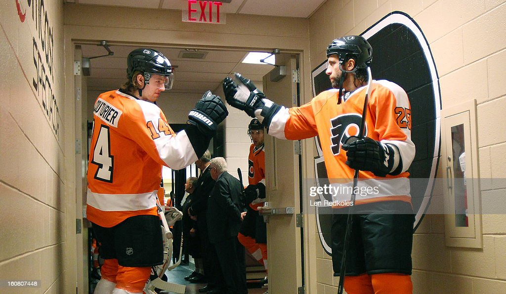 Maxime Talbot #25 and Sean Couturier #14 of the Philadelphia Flyers prepare to enter the ice surface for warmups prior to their game against the Carolina Hurricanes on February 2, 2013 at the Wells Fargo Center in Philadelphia, Pennsylvania.