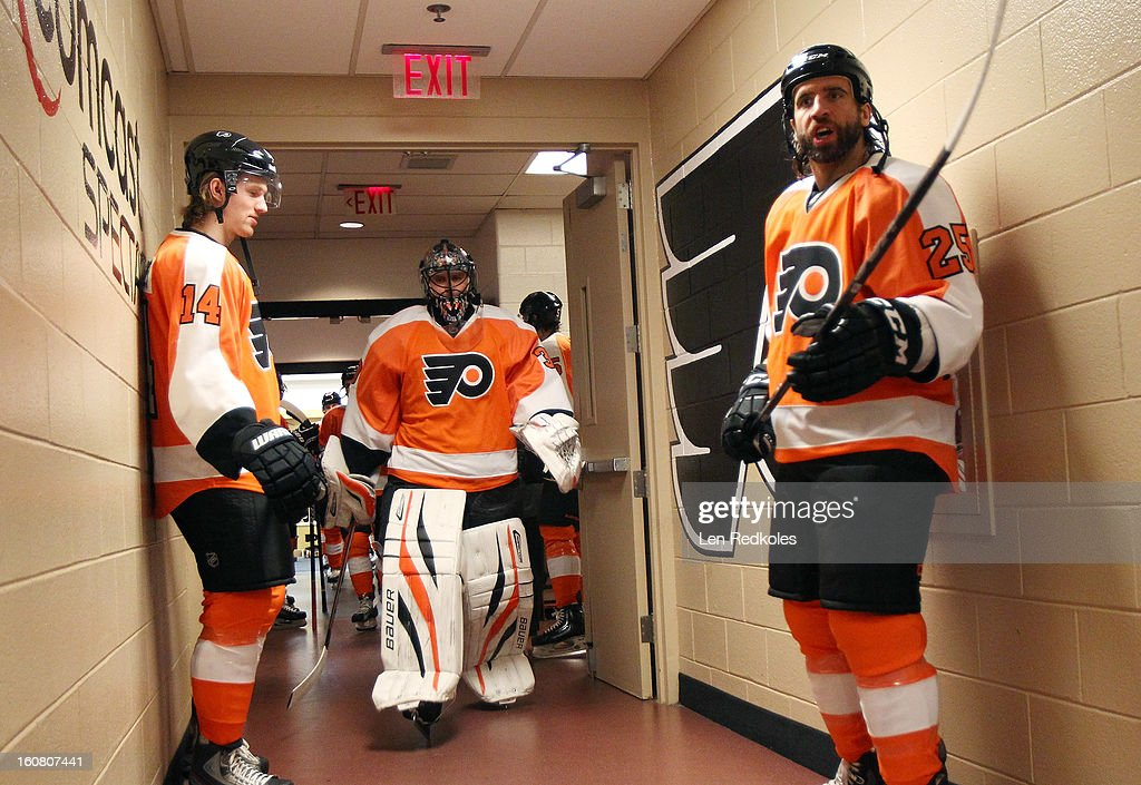 Maxime Talbot #25, Ilya Bryzgalov #30 and Sean Couturier #14 of the Philadelphia Flyers prepare to enter the ice surface for warmups prior to their game against the Carolina Hurricanes on February 2, 2013 at the Wells Fargo Center in Philadelphia, Pennsylvania.