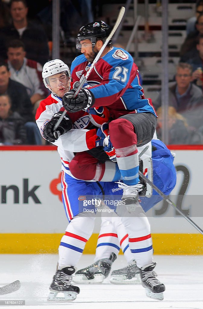 Maxime Talbot #25 of the Colorado Avalanche collides with Michael Bournival #49 of the Montreal Canadiens at Pepsi Center on November 2, 2013 in Denver, Colorado. The Avalanche defeated the Montreal Canadiens 4-1.