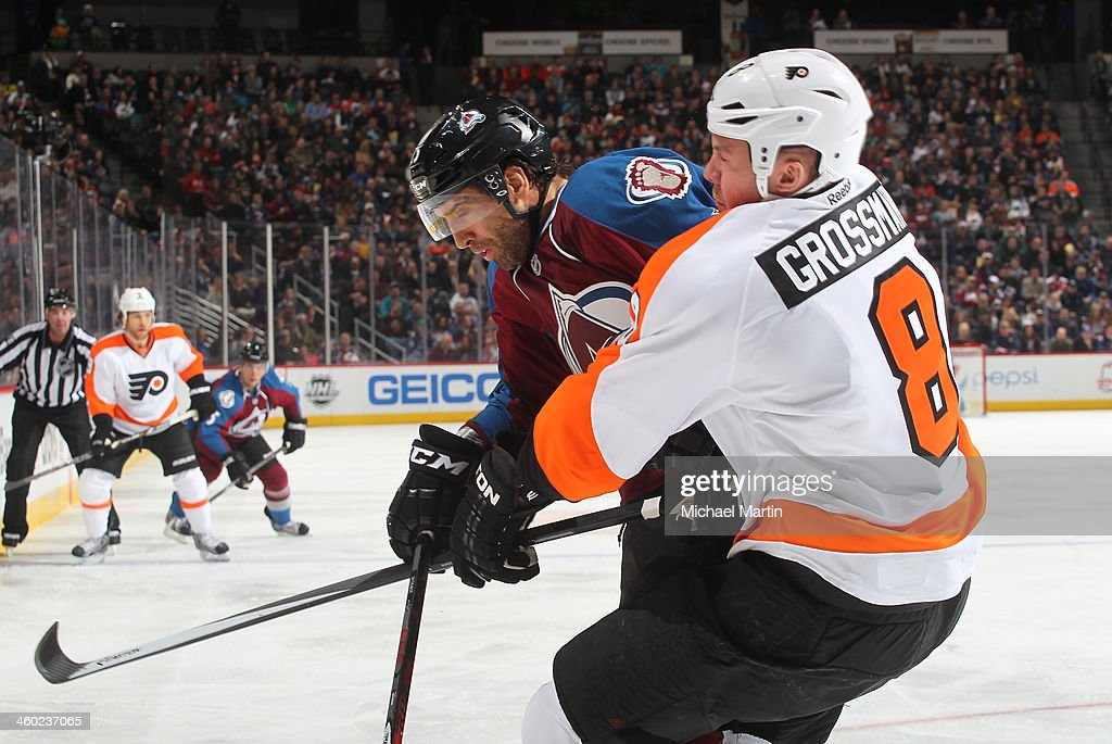 <a gi-track='captionPersonalityLinkClicked' href=/galleries/search?phrase=Maxime+Talbot&family=editorial&specificpeople=2078922 ng-click='$event.stopPropagation()'>Maxime Talbot</a> #25 of the Colorado Avalanche collidies with <a gi-track='captionPersonalityLinkClicked' href=/galleries/search?phrase=Nicklas+Grossman&family=editorial&specificpeople=2284863 ng-click='$event.stopPropagation()'>Nicklas Grossman</a>n #8 of the Philadelphia Flyers at the Pepsi Center on January, 2014 in Denver, Colorado.