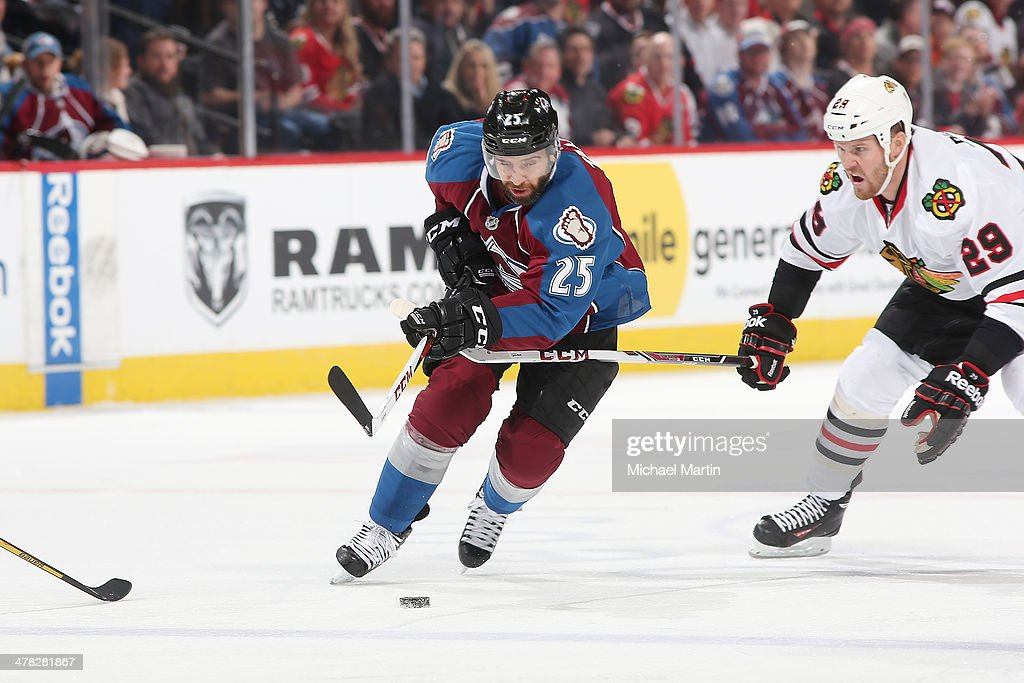 <a gi-track='captionPersonalityLinkClicked' href=/galleries/search?phrase=Maxime+Talbot&family=editorial&specificpeople=2078922 ng-click='$event.stopPropagation()'>Maxime Talbot</a> #25 of the Colorado Avalanche skates with the puck as he is challenged by <a gi-track='captionPersonalityLinkClicked' href=/galleries/search?phrase=Bryan+Bickell&family=editorial&specificpeople=241498 ng-click='$event.stopPropagation()'>Bryan Bickell</a> #29 of the Chicago Blackhawks at the Pepsi Center on March 12, 2014 in Denver, Colorado. The Avalanche defeated the Blackhawks 3-2.