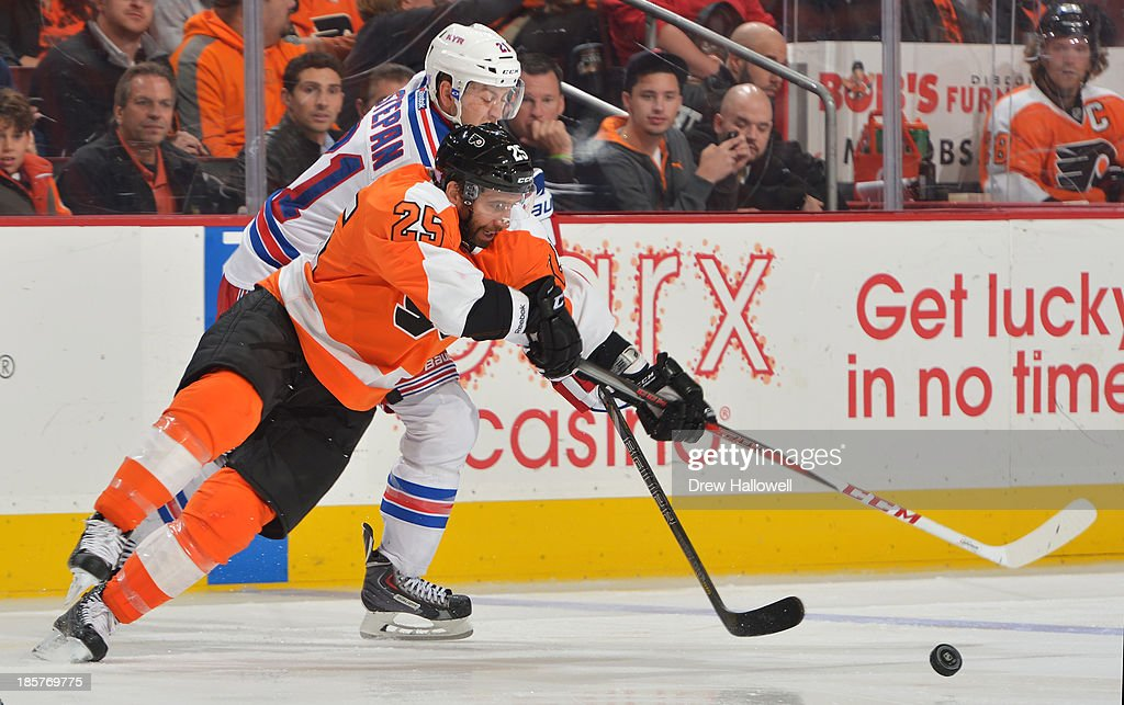<a gi-track='captionPersonalityLinkClicked' href=/galleries/search?phrase=Maxime+Talbot&family=editorial&specificpeople=2078922 ng-click='$event.stopPropagation()'>Maxime Talbot</a> #25 of the Philadelphia Flyers and <a gi-track='captionPersonalityLinkClicked' href=/galleries/search?phrase=Derek+Stepan&family=editorial&specificpeople=4687181 ng-click='$event.stopPropagation()'>Derek Stepan</a> #21 of the New York Rangers battle for the puck at the Wells Fargo Center on October 24, 2013 in Philadelphia, Pennsylvania. The Flyers won 2-1.