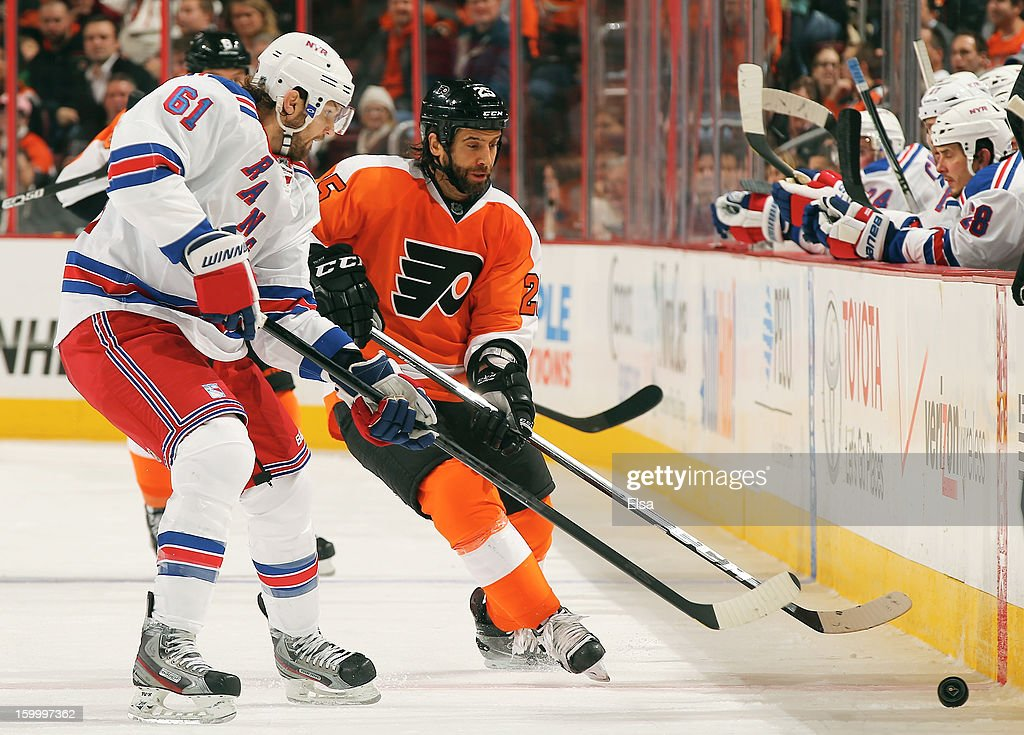 <a gi-track='captionPersonalityLinkClicked' href=/galleries/search?phrase=Maxime+Talbot&family=editorial&specificpeople=2078922 ng-click='$event.stopPropagation()'>Maxime Talbot</a> #25 of the Philadelphia Flyers and <a gi-track='captionPersonalityLinkClicked' href=/galleries/search?phrase=Rick+Nash&family=editorial&specificpeople=202196 ng-click='$event.stopPropagation()'>Rick Nash</a> #61 of the New York Rangers fight for the puck on January 24, 2013 at the Wells Fargo Center in Philadelphia, Pennsylvania.