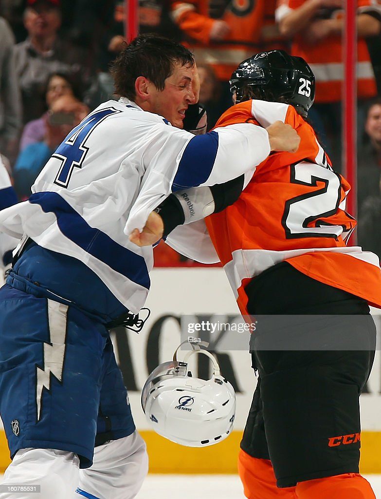 Maxime Talbot #25 of the Philadelphia Flyers and Vincent Lecavalier #4 of the Tampa Bay Lightning fight in the third period on February 5, 2013 at the Wells Fargo Center in Philadelphia, Pennsylvania.The Philadelphia Flyers defeated the Tampa Bay Lightning 2-1.
