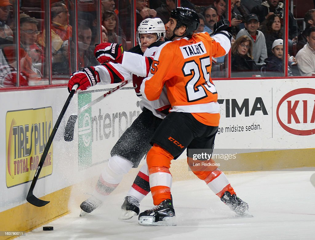 <a gi-track='captionPersonalityLinkClicked' href=/galleries/search?phrase=Maxime+Talbot&family=editorial&specificpeople=2078922 ng-click='$event.stopPropagation()'>Maxime Talbot</a> #25 of the Philadelphia Flyers checks Patrick Elias #26 of the New Jersey Devils into the boards as they pursue the loose puck on March 15, 2013 at the Wells Fargo Center in Philadelphia, Pennsylvania.