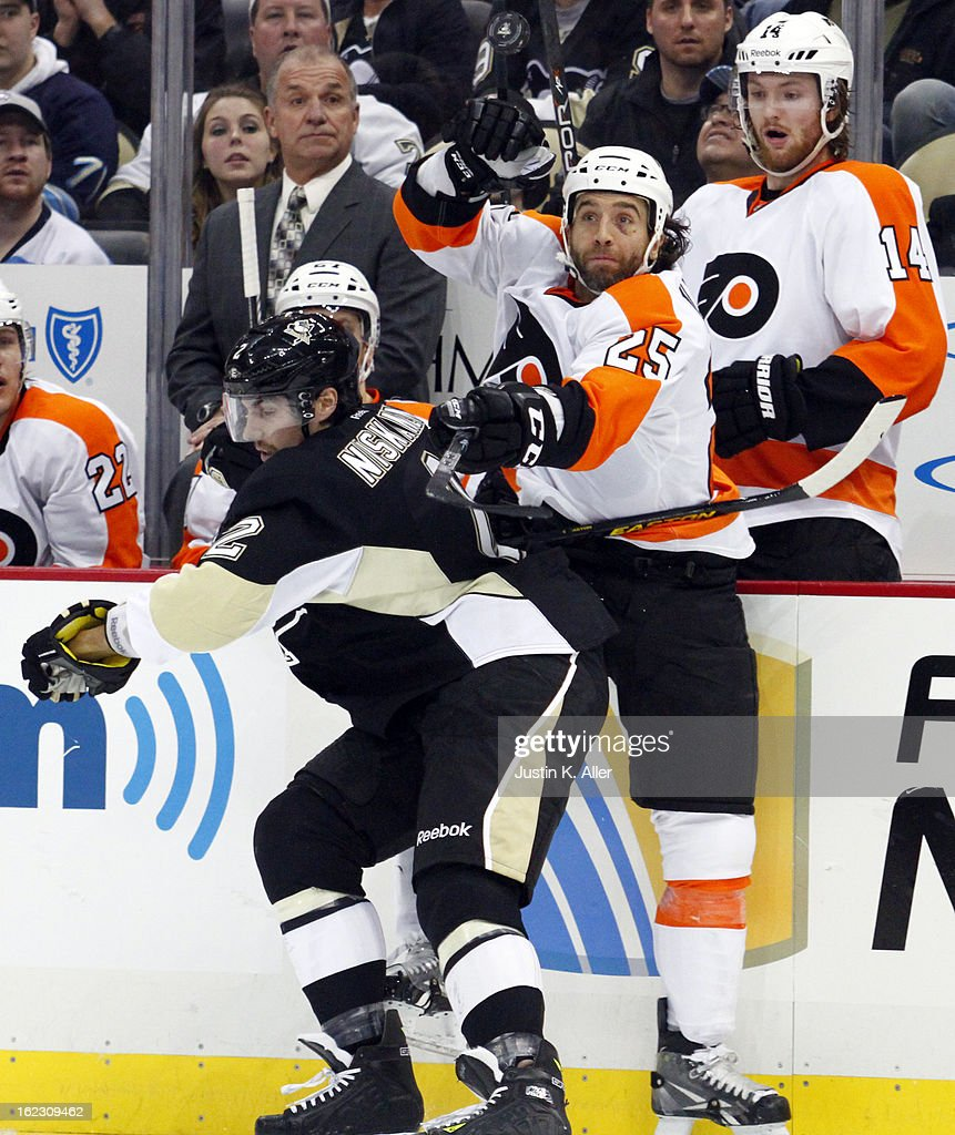 Maxime Talbot #25 of the Philadelphia Flyers eyes the puck in front of Matt Niskanen #2 of the Pittsburgh Penguins during the game at Consol Energy Center on February 20, 2013 in Pittsburgh, Pennsylvania.