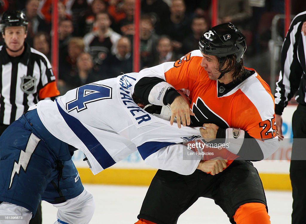 Maxime Talbot #25 of the Philadelphia Flyers fights Vincent LeCavalier #4 of the Tampa Bay Lightning in the third period on February 5, 2013 at the Wells Fargo Center in Philadelphia, Pennsylvania.
