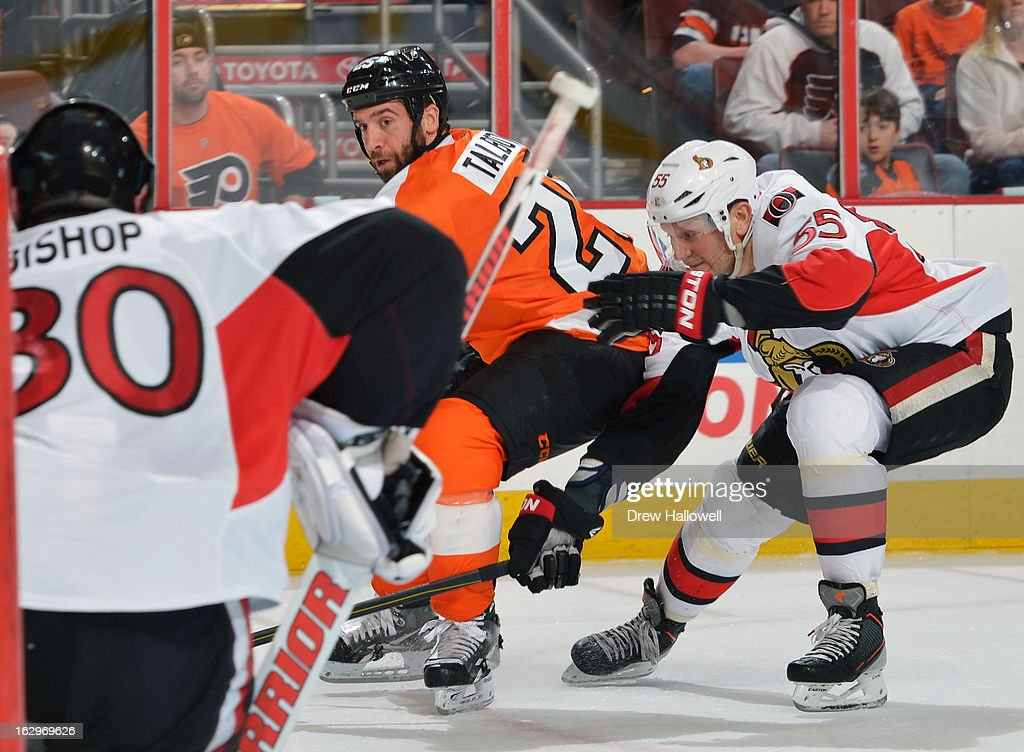 <a gi-track='captionPersonalityLinkClicked' href=/galleries/search?phrase=Maxime+Talbot&family=editorial&specificpeople=2078922 ng-click='$event.stopPropagation()'>Maxime Talbot</a> #25 of the Philadelphia Flyers tries to get a shot off on <a gi-track='captionPersonalityLinkClicked' href=/galleries/search?phrase=Ben+Bishop&family=editorial&specificpeople=700137 ng-click='$event.stopPropagation()'>Ben Bishop</a> #30 of the Ottawa Senators while being defended by <a gi-track='captionPersonalityLinkClicked' href=/galleries/search?phrase=Sergei+Gonchar&family=editorial&specificpeople=202470 ng-click='$event.stopPropagation()'>Sergei Gonchar</a> #55 of the Ottawa Senators at the Wells Fargo Center on March 2, 2013 in Philadelphia, Pennsylvania.