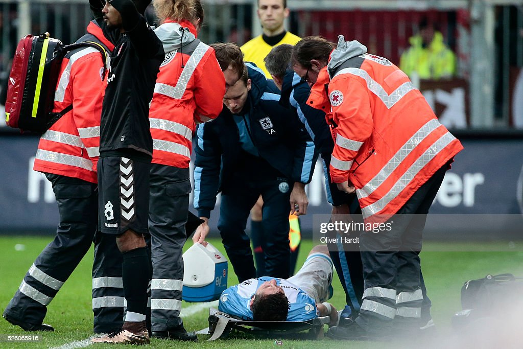 Maximilan Wittek of Muenchen injured during the Second Bundesliga match between FC St. Pauli and 1860 Muenchen at Millerntor Stadium on April 29, 2016 in Hamburg, Germany.