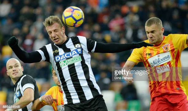 Maximiliam Lopez of Udinese Calcio competes with George Puscas of Benevento Calcio during the Serie A match between Udinese Calcio and Benevento...