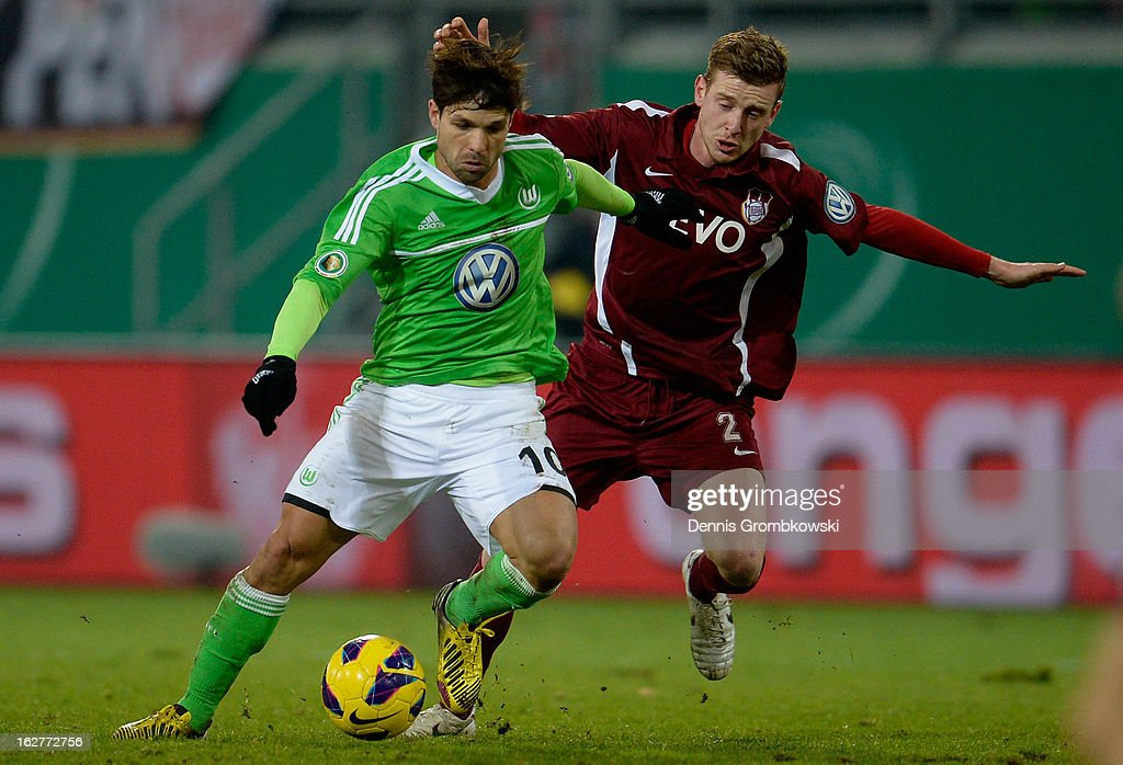 Maximilian Ahlschwede of Offenbach challenges Diego of Wolfsburg during the DFB Cup match between Kickers Offenbach and VfL Wolfsburg on February 26, 2013 in Offenbach, Germany.