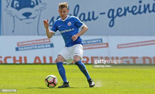 Maximilian Ahlschwede of Rostock runs with the ball during the third league match between FC Hansa Rostock and 1FC Magdeburg at Ostseestadion on...