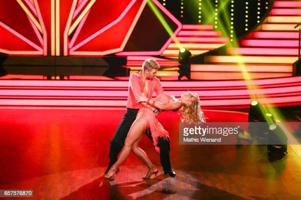 Maximilian Arland and Isabel Edvardsson perform on stage during the 2nd show of the tenth season of the television competition 'Let's Dance' on March...