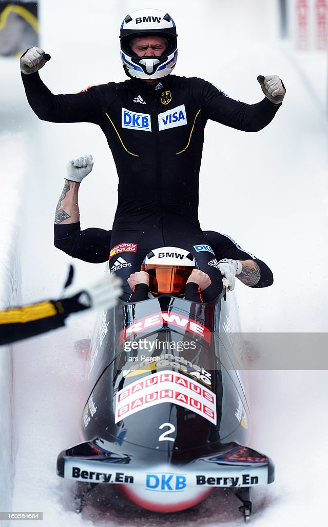 Maximilian Arndt, Marko Huebenbecker, Alexander Roediger and Martin Putze of Germany celebrate after the Four Men Bobsleigh final heat of the IBSF Bob & Skeleton World Championship at Olympia Bob Run on February 3, 2013 in St Moritz, Switzerland.