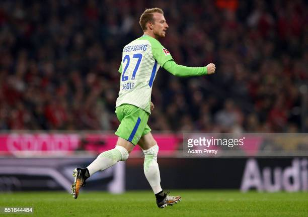 Maximilian Arnold celebrates after he scores a goal of Wolfsburg battle for the ball during the Bundesliga match between FC Bayern Muenchen and VfL...
