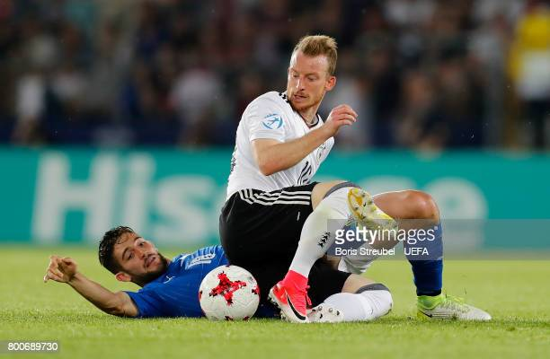 Maximilian Arnold of Germany and Roberto Gagliardini of Italy fight for the ball during the UEFA European Under21 Championship Group C match between...
