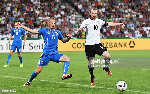 Maximilian Arnold of Germany is challenged by Denis Vavro of Slovakia during the Under21 friendly match between U21 Germany and U21 Slovakia at...