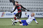 Maximilian Arnold of Germany is challenged by Hakun Edmundsson of Faroe Island during the 2017 UEFA European U21 Championships Qualifier between U21...