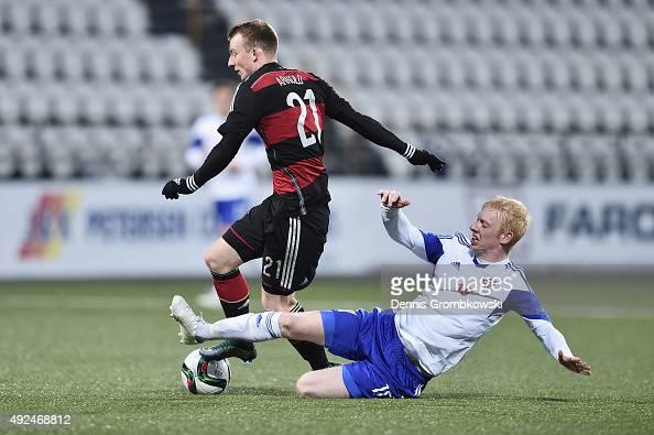 Maximilian Arnold of Germany is challenged by Hakun Edmundsson of Faroe Island during the 2017 UEFA European U21 Championships Qualifier between U21...