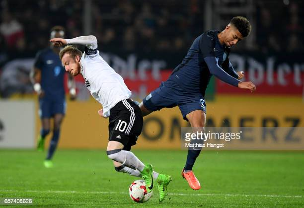 Maximilian Arnold of Germany is challenged by Mason Colgate of England during the U21 international friendly match between Germany and England at...
