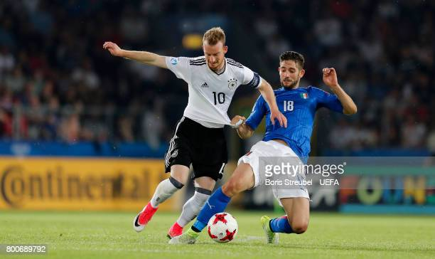 Maximilian Arnold of Germany is challenged by Roberto Gagliardini of Italy during the UEFA European Under21 Championship Group C match between Italy...