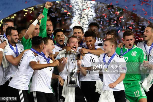 Maximilian Arnold of Germany lifts the trophy with his Germany team mates after the UEFA European Under21 Championship Final between Germany and...