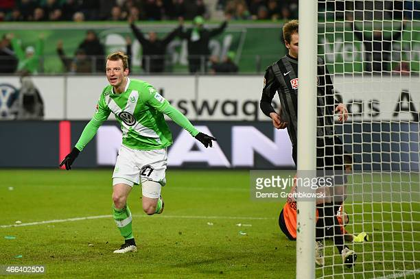 Maximilian Arnold of VfL Wolfsburg celebrates as he scores the third goal during the Bundesliga match between VfL Wolfsburg and SC Freiburg at...