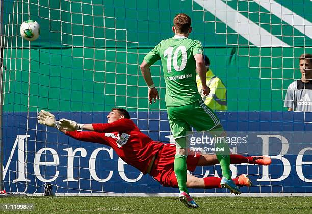 Maximilian Arnold of VfL Wolfsburg scores his team's second goal by penalty during the A Juniors Bundesliga final match between FC Hansa Rostock and...