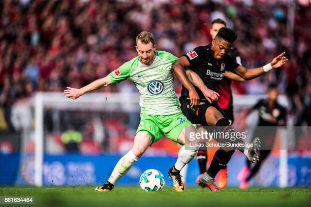 Maximilian Arnold of Wolfsburg and Leon Bailey of Leverkusen in action during the Bundesliga match between Bayer 04 Leverkusen and VfL Wolfsburg at...
