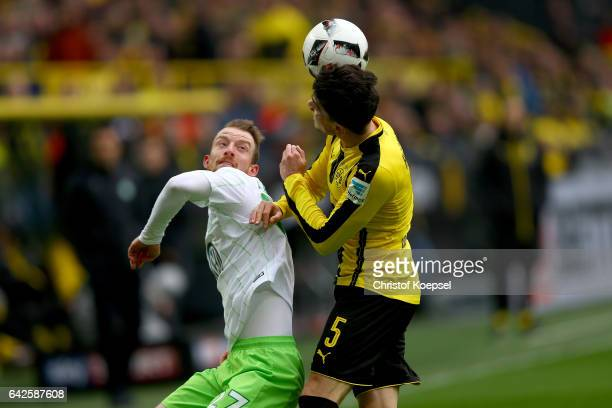 Maximilian Arnold of Wolfsburg and Marc Bartra of Dortmund go up for a header during the Bundesliga match between Borussia Dortmund and VfL Wolfsburg...