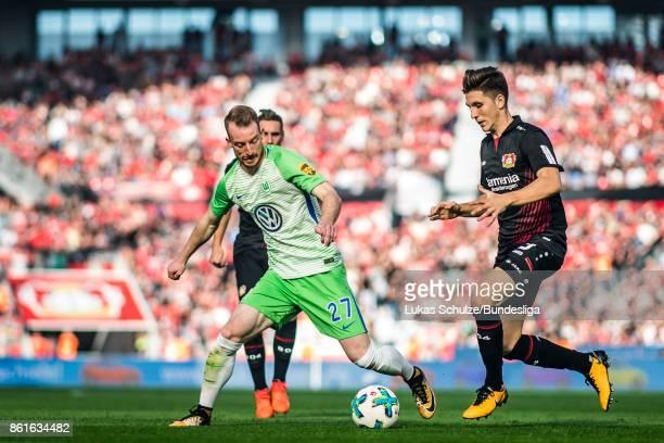 Maximilian Arnold of Wolfsburg and Panagiotis Retsos of Leverkusen in action during the Bundesliga match between Bayer 04 Leverkusen and VfL...