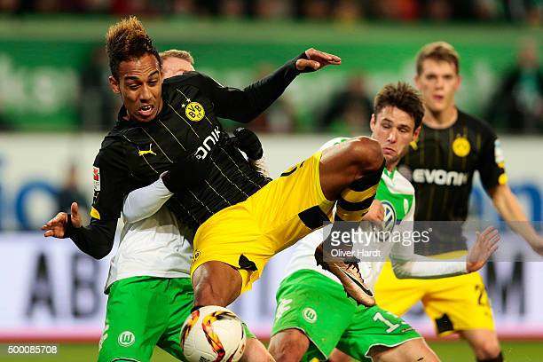 Maximilian Arnold of Wolfsburg and Patrick Emerick Aubameyang of Dortmund compete for the ball during the First Bundesliga match at between VfL...