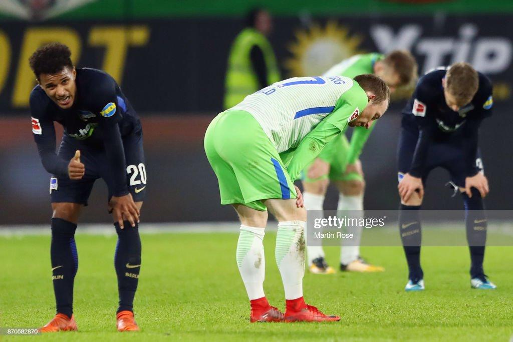 Maximilian Arnold (C) of Wolfsburg and Valentino Lazaro (L) of Berlin react after the Bundesliga match between VfL Wolfsburg and Hertha BSC at Volkswagen Arena on November 5, 2017 in Wolfsburg, Germany.