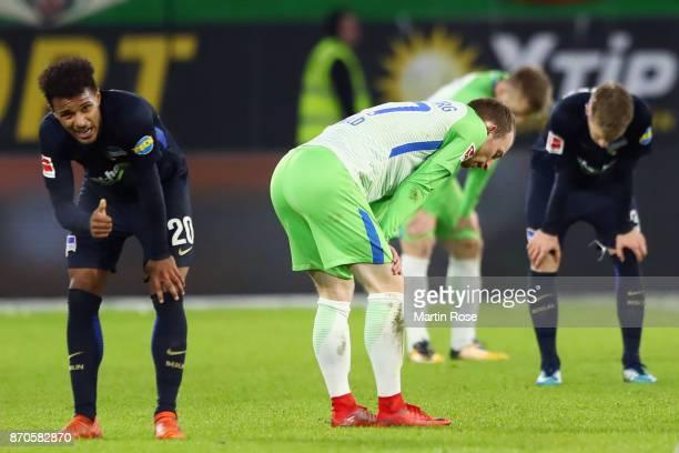 Maximilian Arnold of Wolfsburg and Valentino Lazaro of Berlin react after the Bundesliga match between VfL Wolfsburg and Hertha BSC at Volkswagen...