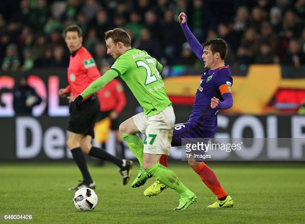 Maximilian Arnold of Wolfsburg and Zlatko Junuzovic battle for the ball during the Bundesliga match between VfL Wolfsburg and Werder Bremen at...