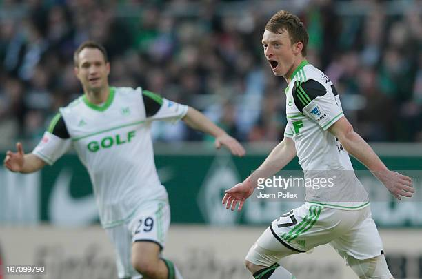 Maximilian Arnold of Wolfsburg celebrates after scoring his team's first goal during the Bundesliga match between SV Werder Bremen and VfL Wolfsburg...