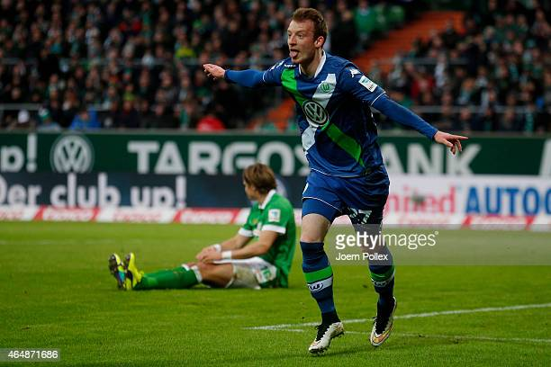 Maximilian Arnold of Wolfsburg celebrates after scoring his team's second goal during the Bundesliga match between SV Werder Bremen and VfL Wolfsburg...