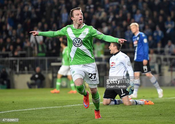 Maximilian Arnold of Wolfsburg celebrates after scoring his team's fourth goal during the DFB Cup Semi Final match between Arminia Bielefeld and VfL...