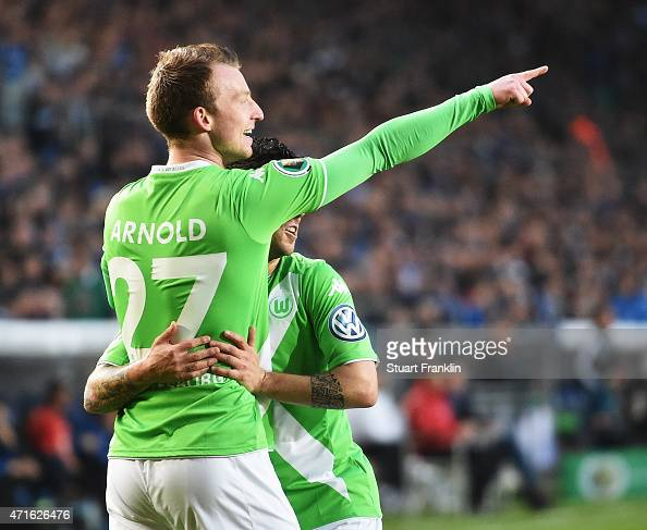 Maximilian Arnold of Wolfsburg celebrates his first goal with Vieira during the DFB Cup semi final match between Arminia Bielefeld and VfL Wolfsburg...