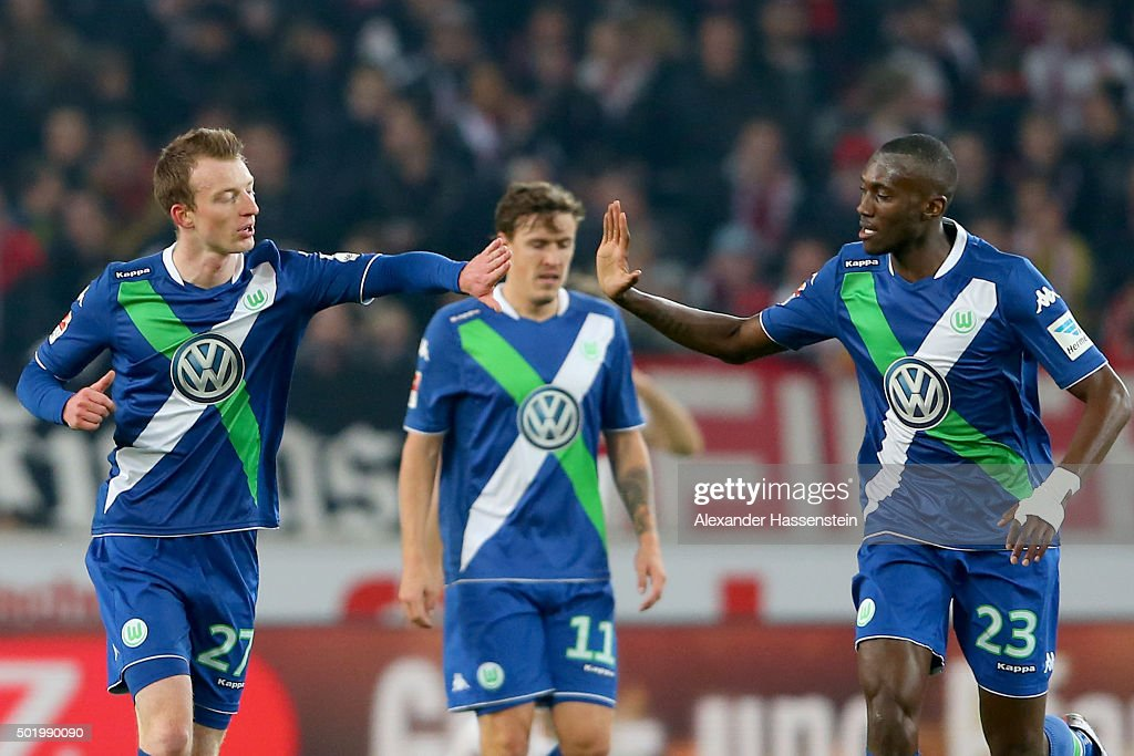 Maximilian Arnold (L) of Wolfsburg celebrates scoring the opening goal with his team mate Joshua Guilavogui (R) during the Bundesliga match between VfB Stuttgart and VfL Wolfsburg at Mercedes-Benz Arena on December 19, 2015 in Stuttgart, Germany.