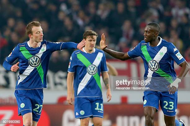 Maximilian Arnold of Wolfsburg celebrates scoring the opening goal with his team mate Joshua Guilavogui during the Bundesliga match between VfB...