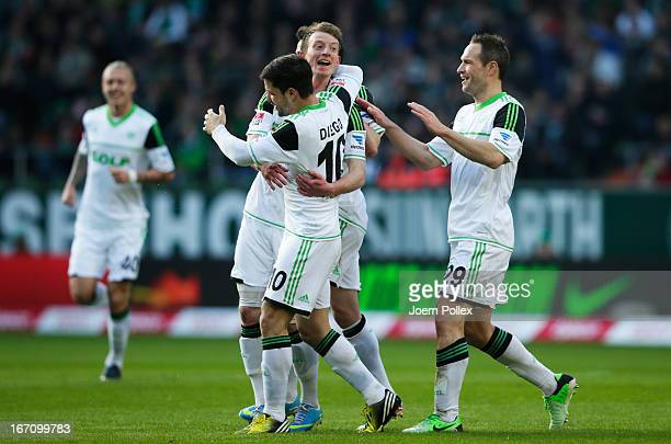 Maximilian Arnold of Wolfsburg celebrates with his team mates after scoring his team's first goal during the Bundesliga match between SV Werder...