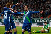 Maximilian Arnold of Wolfsburg celebrates with his team mates after scoring his team's second goal during the Bundesliga match between SV Werder...