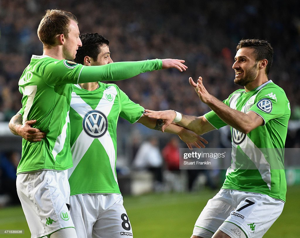 <a gi-track='captionPersonalityLinkClicked' href=/galleries/search?phrase=Maximilian+Arnold&family=editorial&specificpeople=7166144 ng-click='$event.stopPropagation()'>Maximilian Arnold</a> (L) of Wolfsburg celebrates with his team-mates Freitas De-Vieirinha (C) of Wolfsburg and <a gi-track='captionPersonalityLinkClicked' href=/galleries/search?phrase=Daniel+Caligiuri&family=editorial&specificpeople=6495349 ng-click='$event.stopPropagation()'>Daniel Caligiuri</a> (R) of Wolfsburg after scoring his team's first goal duringduring the DFB Cup Semi Final match between Arminia Bielefeld and VfL Wolfsburg at Schueco Arena on April 29, 2015 in Bielefeld, Germany.