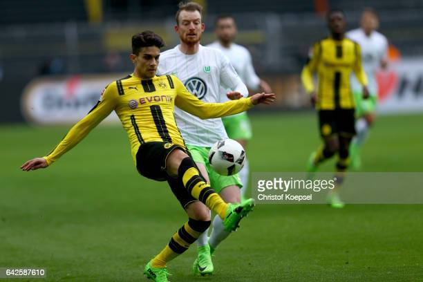Maximilian Arnold of Wolfsburg challenges Marc Bartra of Dortmund during the Bundesliga match between Borussia Dortmund and VfL Wolfsburg at Signal...