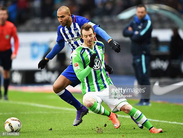Maximilian Arnold of Wolfsburg is challenged by John Anthony Brooks of Berlin during the Bundesliga match between Hertha BSC and VfL Wolfsburg at...